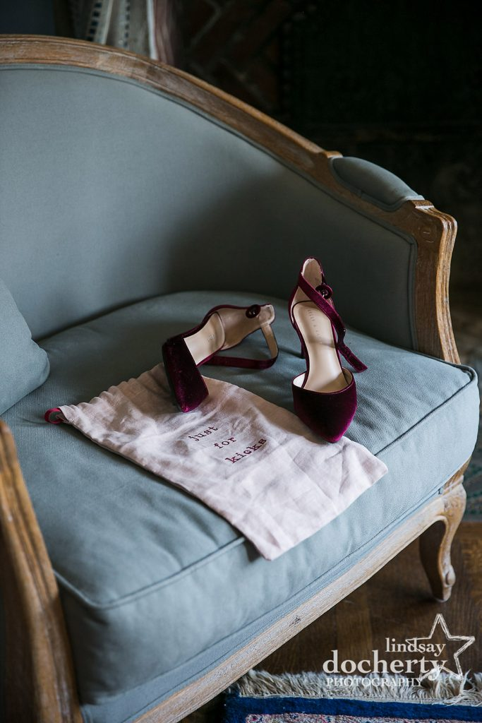brides maroon velvet shoes on chair