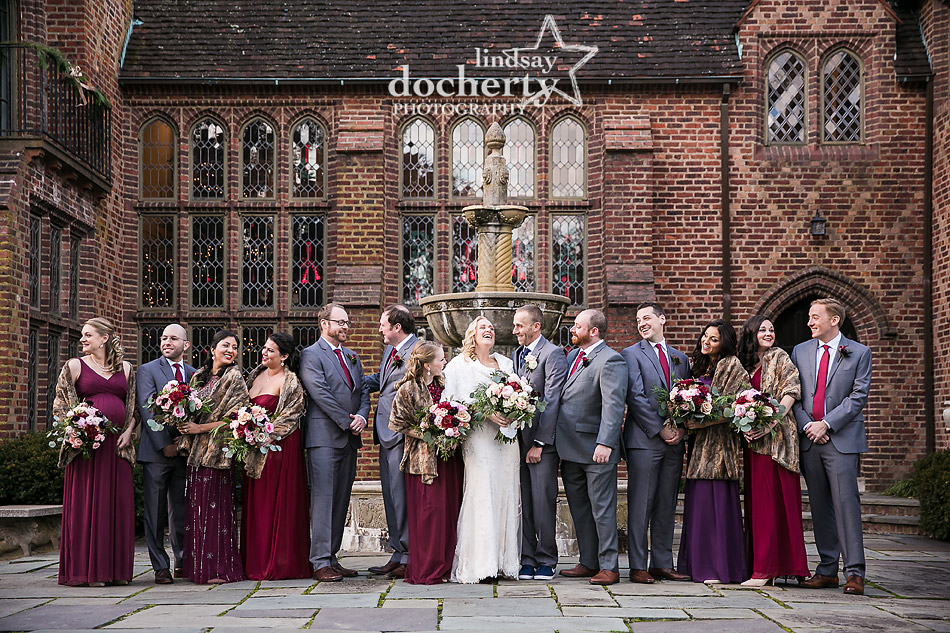 bridesmaids and groomsmen together in jewel tones on winter wedding day
