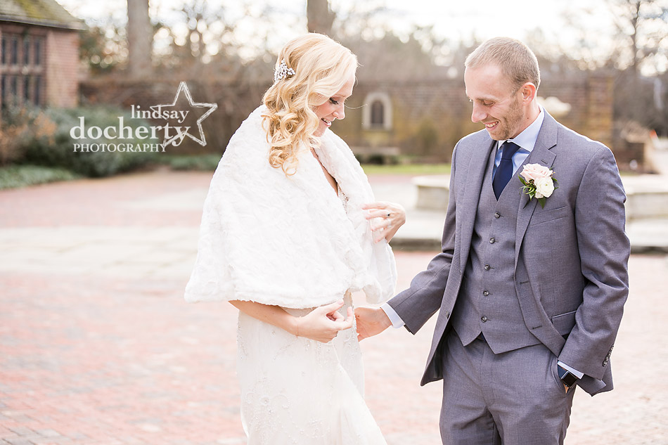 groom admiring bride at Aldie Mansion on winter wedding day