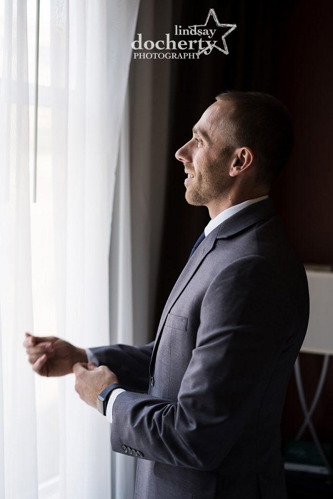 groom in profile on wedding morning