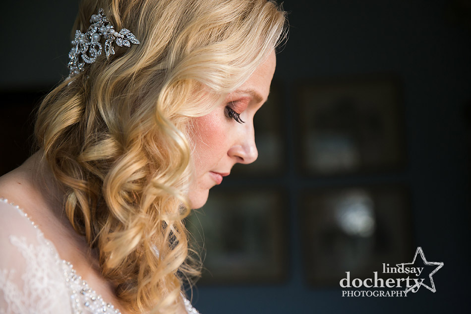 lovely bride with side swept hair on wedding morning