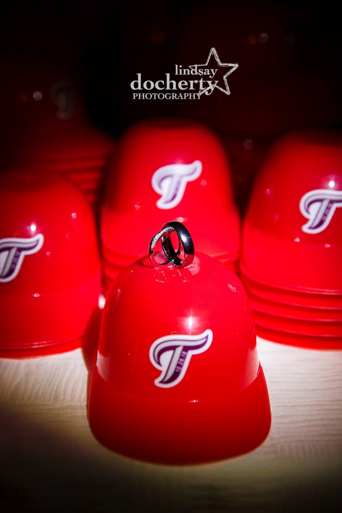wedding rings on baseball hat favor