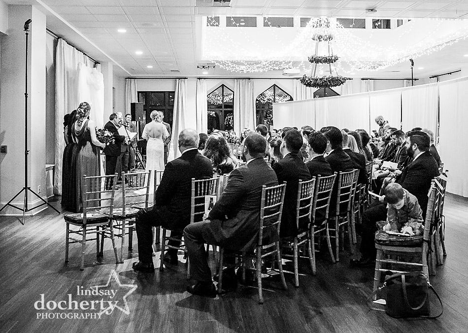 whole room view of winter wedding ceremony at Aldie Mansion