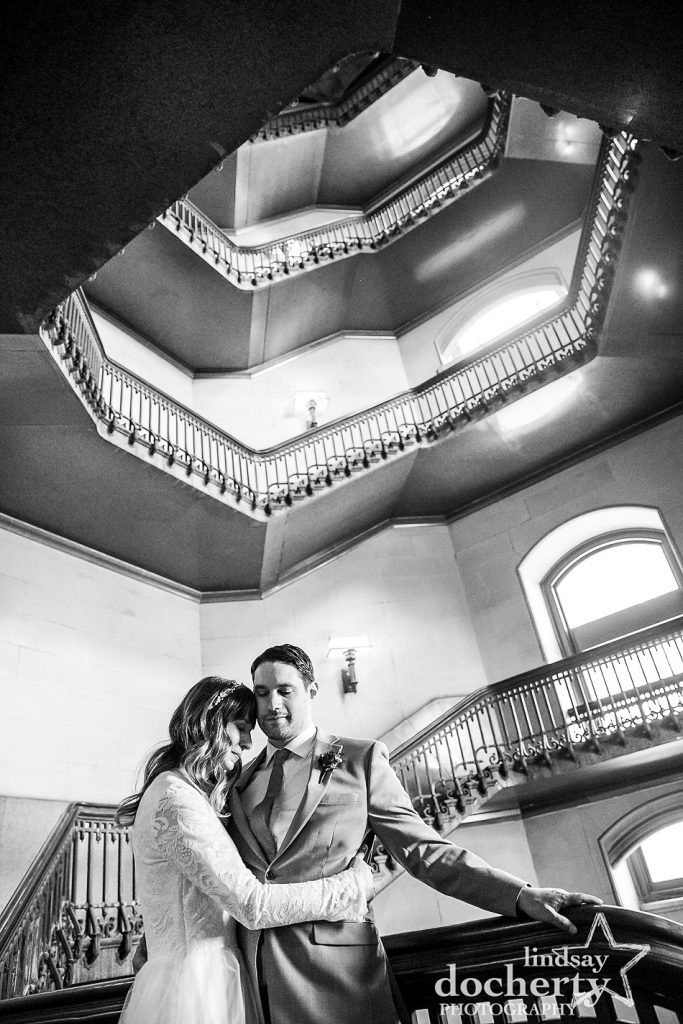 bride and groom in gorgeous historic stairwell at Philadelphia City Hall