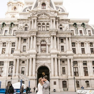 bride and groom kissing outside of wedding ceremony at Philadelphia City Hall