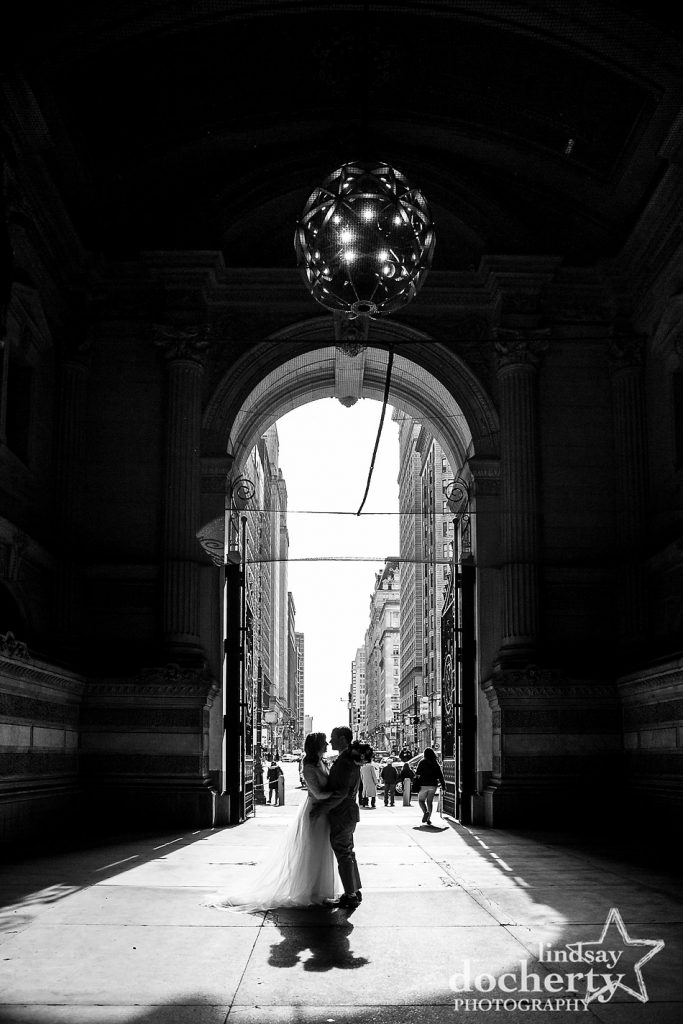 bride and groom silhouette after ceremony at Philadelphia City Hall outside