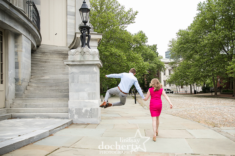 heel kick in the air during engagement session in Philly