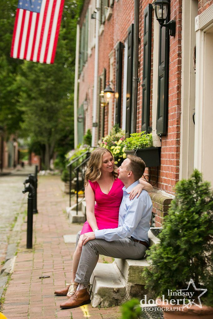 hot pink dress and dapper fiance on cobblestone streets in Philadelphia
