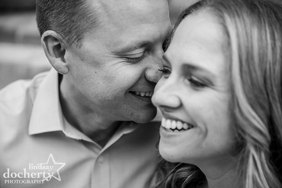 nuzzling fiance in black and white engagement picture