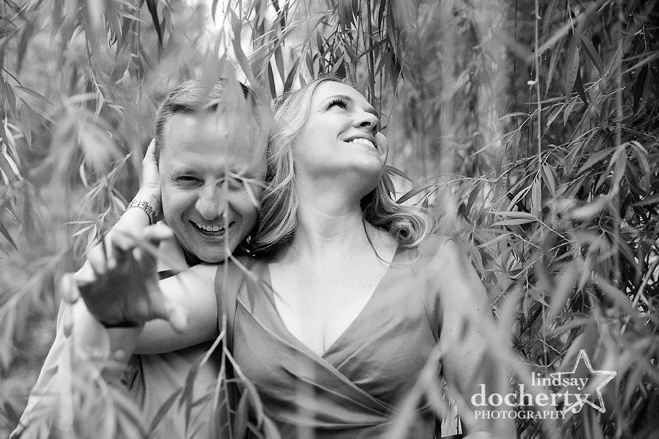 playful couple in engagement pictures in Philadelphia