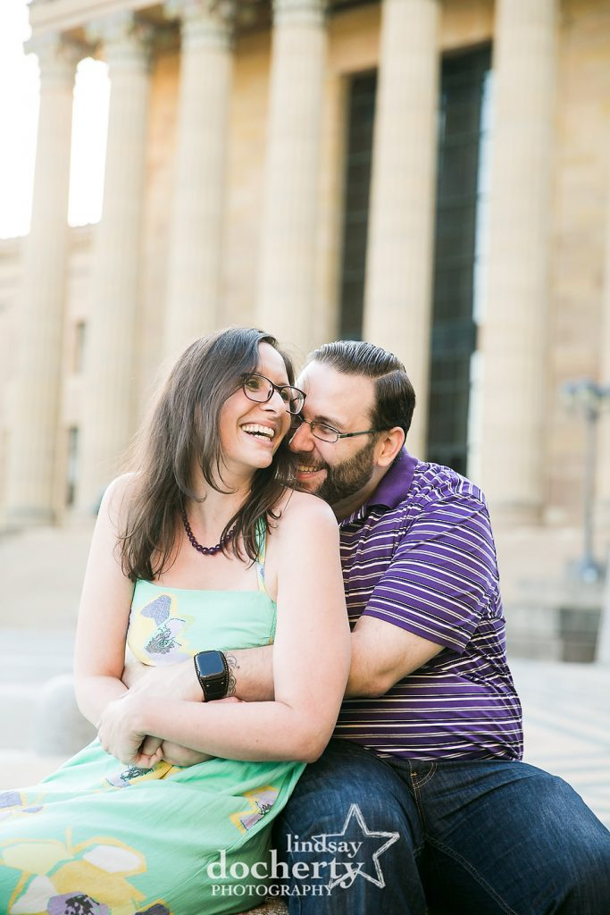 cutesy engagement session picture in front of the Philadelphia Museum of Art