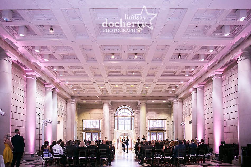 pink lit wedding ceremony at Free Library on the Parkway in Philadelphia
