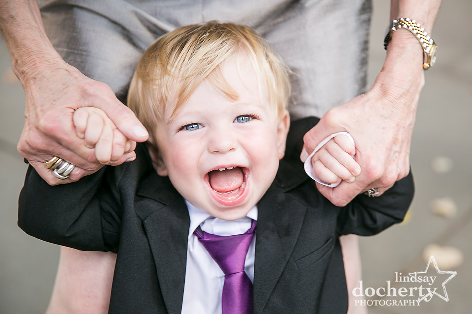 adorable ring bearer with purple tie