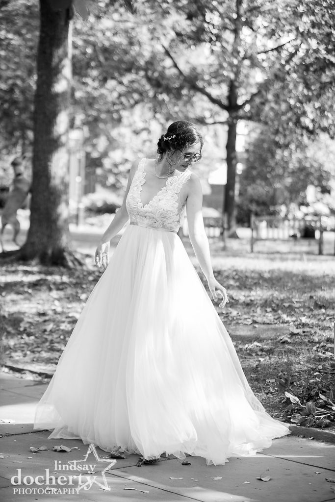 bride in gorgeous wedding gown in Washington Square Park