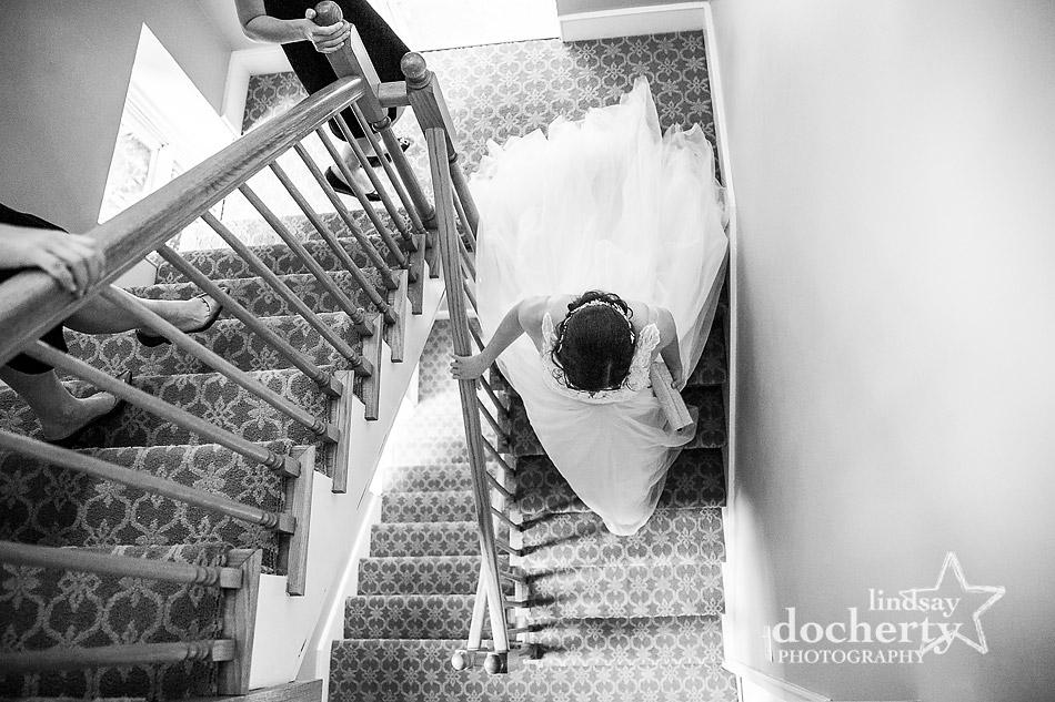 bride walks down stairs at Morris House Hotel in Philadelphia