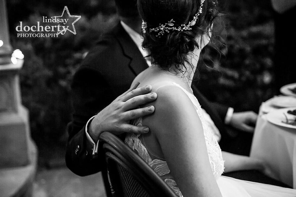 gentle shoulder touch between groom and bride