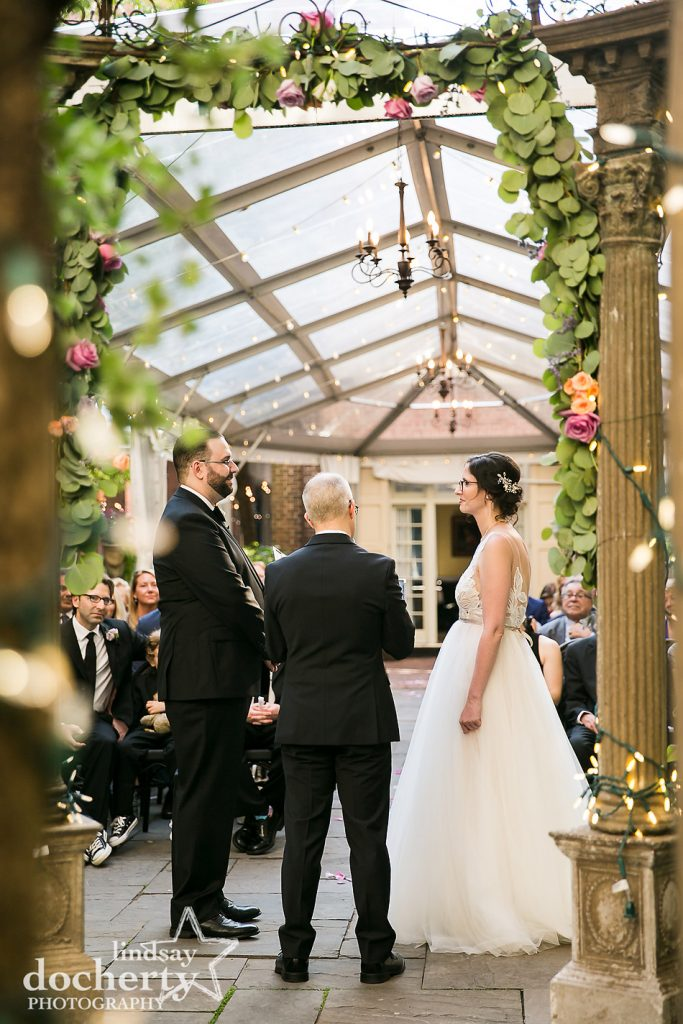 wedding ceremony from behind at Morris House Hotel in Philadelphia