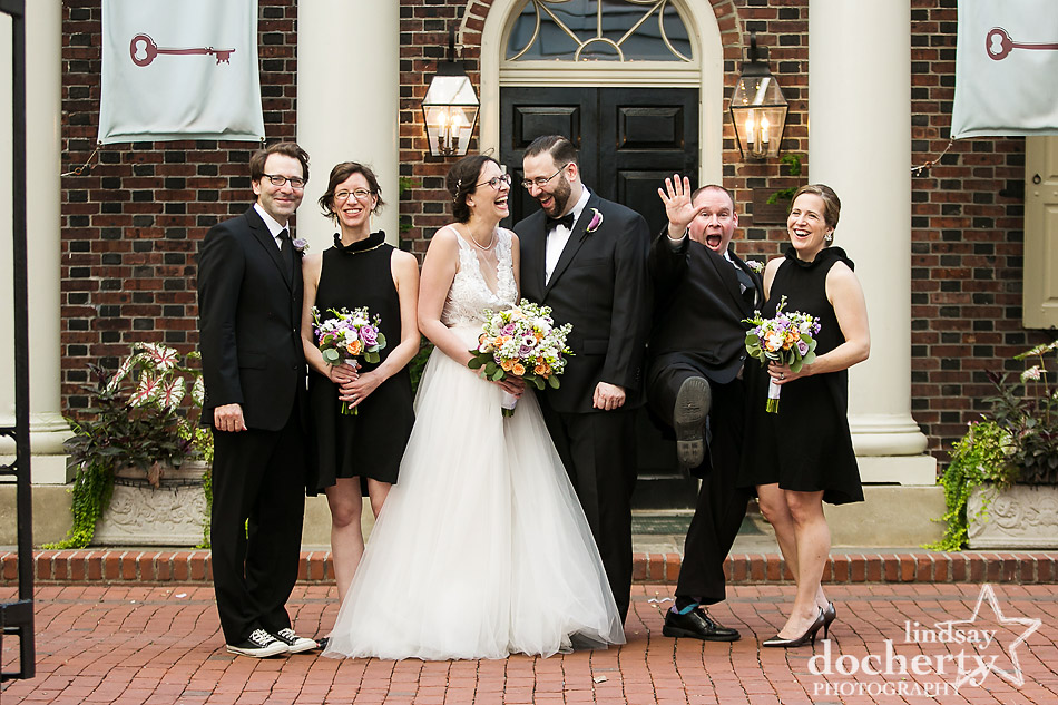 wedding party goofing off in front of Morris House Hotel in Philadelphia