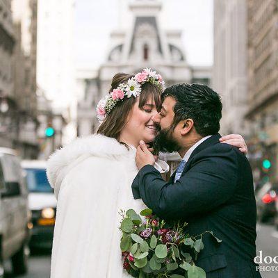 winter wedding bride and groom kissing on Broad Street in Philadelphia
