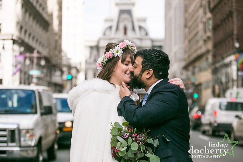 winter wedding bride and groom kissing on Broad Street in Philadelphia