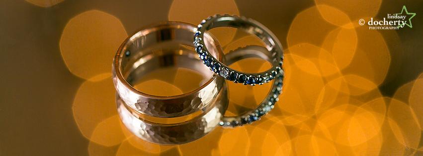 macro sapphire wedding rings with bokeh