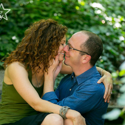 Natural green park engagement session along Kelly drive with an amazing kiss