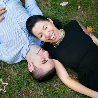 Tattooed couple laughing in Philadelphia Rittenhouse Square Park engagement session