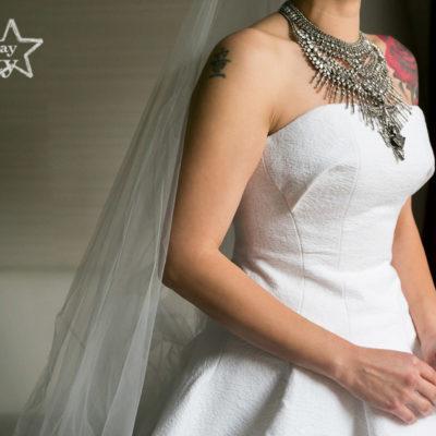 tattooed bride in handmade wedding dress with heavy metal statement necklace