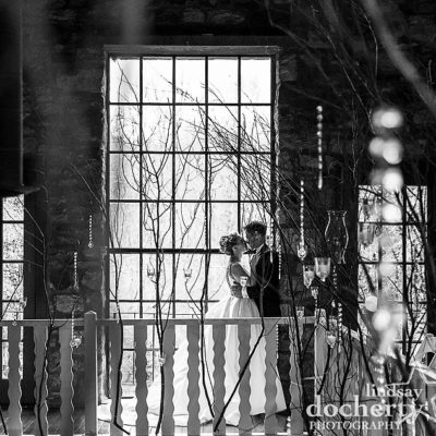 bride and groom at winter Holly Hedge wedding in the chapel