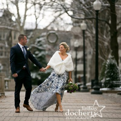 Snowy winter wedding in Philadelphia Rittenhouse Square bride in fur and hi lo blue dress