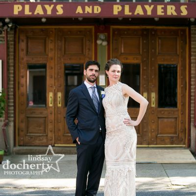 bride and Argentinian husband on wedding day in front of Plays and Players in Rittenhouse Square