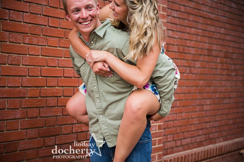 piggyback ride during engagement session in Old City Philly
