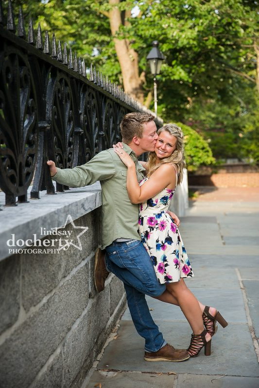 sweet couple kissing at iron fence in Old City Philadelphia