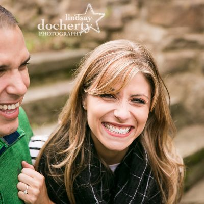 hot couple laughing at Ridley Creek State Park for engagement session