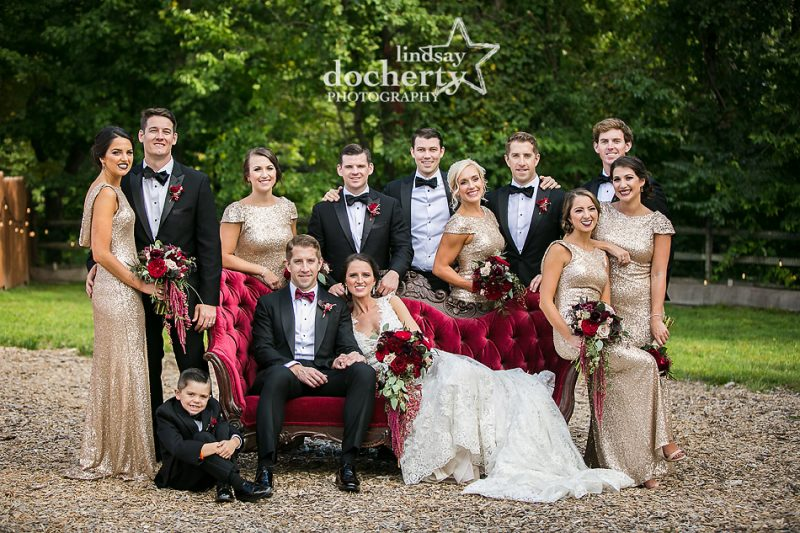 gorgeous deep red antique chaise lounge with wedding party at Audubon Center