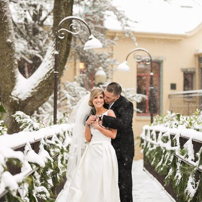 bride and groom outside in snow on wedding day at Pomme in Radnor