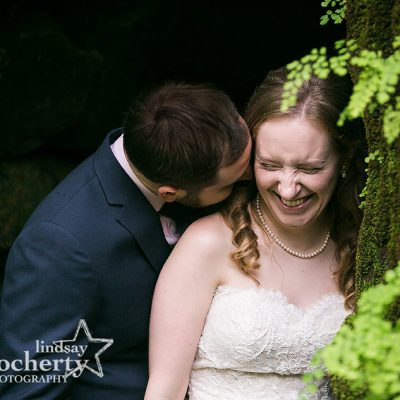 bride and groom in fernery at Morris Arboretum on wedding day