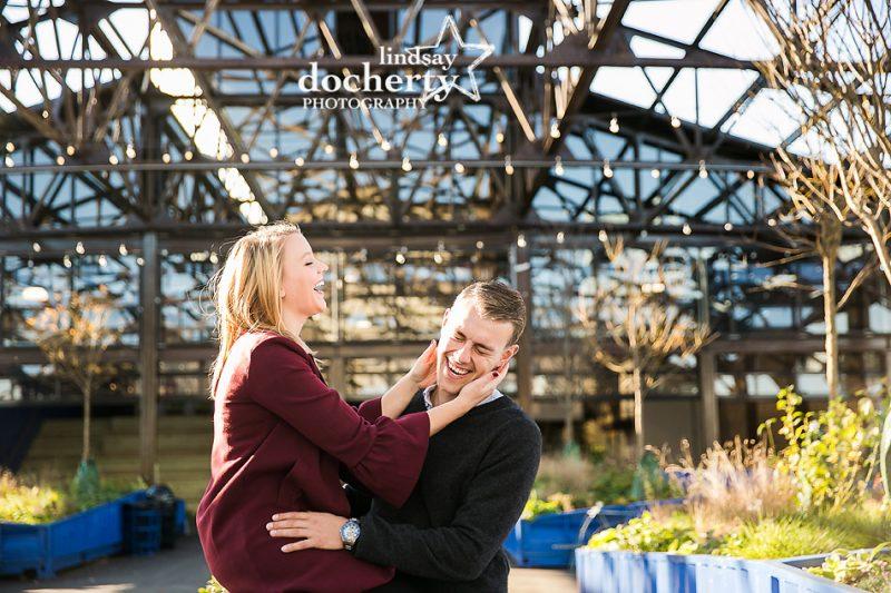 playful couple at Cherry Street Pier in philadelphia