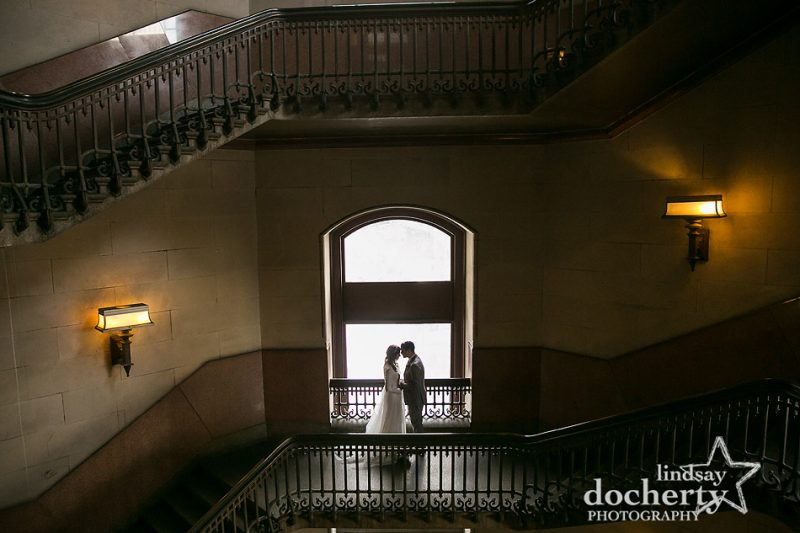 bride and groom in stairwell at Philadelphia City Hall after courthouse ceremony