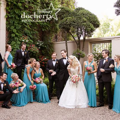 wedding party laughing in back garden at Overbrook Golf Club