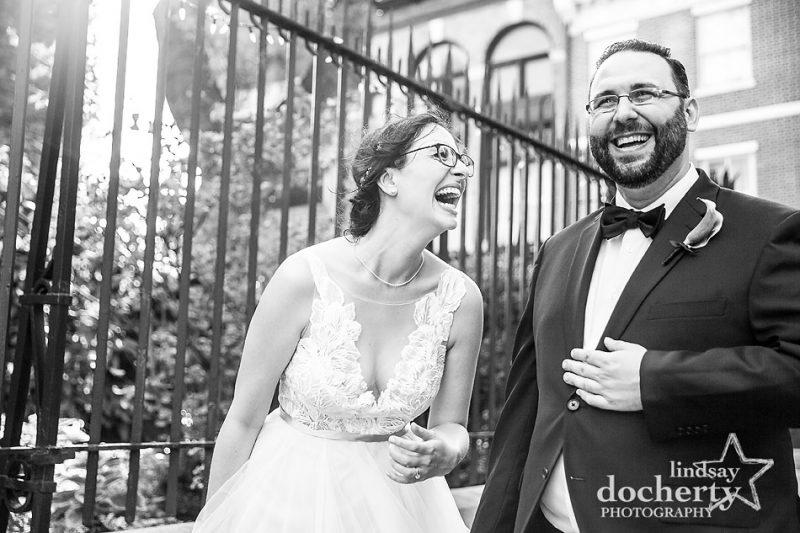 bride and groom laughing outside Morris House Hotel in Philadelphia