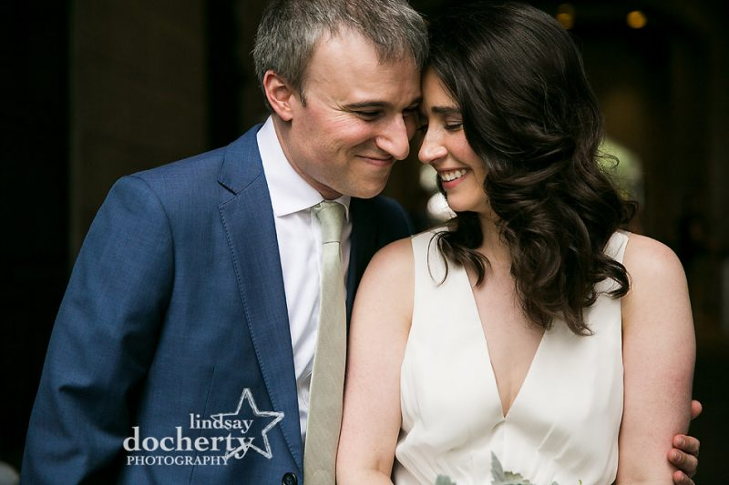 sweet intimate closeup moment with bride and groom in blue suit