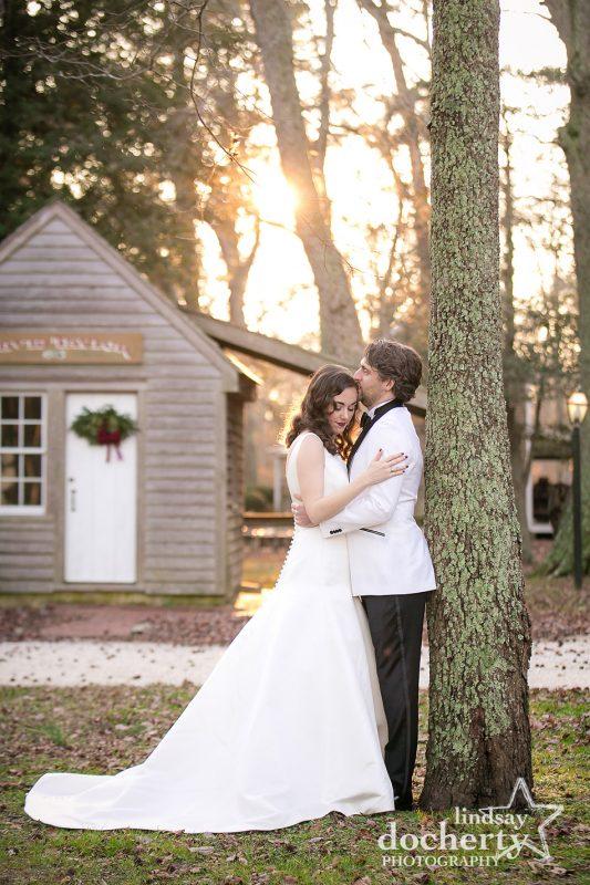 bride and groom in golden winter sunset light at Cold Spring Village