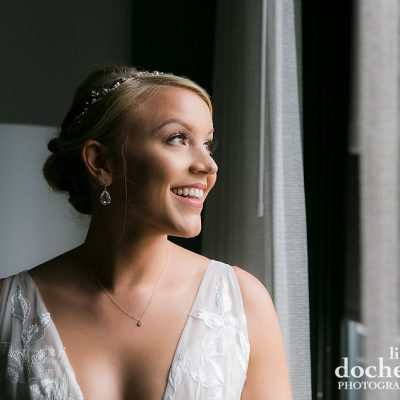 gorgeous bride looking out window
